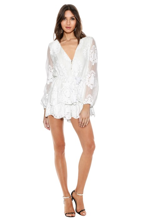 72ac157d9fd7 This gorgeous, soft flowing playsuit is a perfect all white outfit for your White  New Year's Party. Featuring a sheer lace with bold repeated pattern, ...